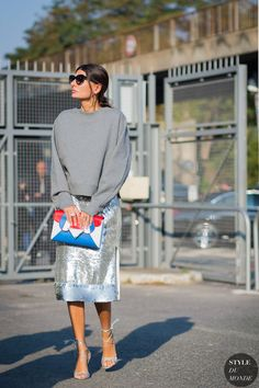 colorful clutch with slouchy sweater and metallic skirt