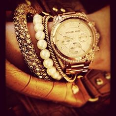 am especially a fan of the stacked bracelets-watch combo. A watch ...
