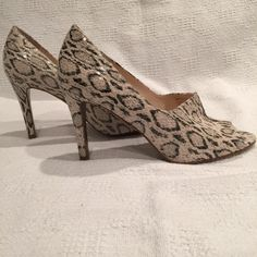 TAHARI animal print open toe pumps TAHARI Animal print open toe pumps. Beautiful , mint condition never worn, brand new. Three inch heel. Size 7 1/2 Tahari Shoes Heels