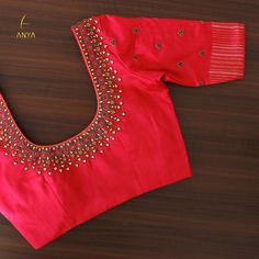 Beautifully crafted with zardosi, french knot and cut bead, this exquisite blouse is perfect for any occasion. Get yours customized today. Blouse Back Neck Designs, Cutwork Blouse Designs, New Saree Blouse Designs, Hand Work Blouse Design, Simple Blouse Designs, Stylish Blouse Design, Bridal Blouse Designs, Sari Blouse, Blouse Styles