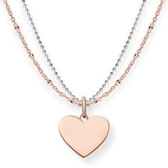 Close to the heart: the feminine engravable double chain with its heart pendant conveys delicate love through the playfulness of this item of jewellery in a sophisticated manner.