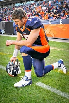 This image relates to religion in football and it depicts Tim Tebow kneeling in prayer during a game. Many fans, devout in their faith or not, are very habitual in their watching of the sport. As it is aired on Sundays it's viewership has replaced, for many people, their attendance in church.