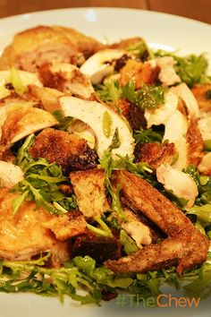 Make a classic Roast Chicken with Bread & Arugula Salad with this recipe from Ina Garten!
