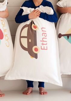 """As a parent, you know that personalized items can be a lifesaver -- specifically when it comes to keeping the word """"mine!"""" from being shouted on a continuous loop. These adorable pillows are the perfect accessory for your little one's room!"""