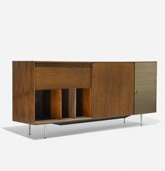 George Nelson & Associates; #5718 'Thin Edge' TV Cabinet for Herman Miller, 1952.