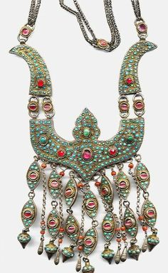 "Bird-shaped necklace with micromosaic turquoise and inlaid glass. From Khiva, Uzbekistan. Posted by Linda Pastorino on ""ethnic jewels"". Probably 19th, possibly 20th century."