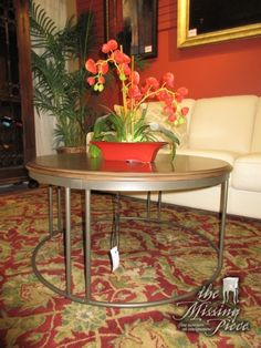 """Round medium wood coffee table on a silver metal base. Perfect for giving your space a touch of an industrial style! At posting, we have two matching end tables. 36""""round x 18""""high."""