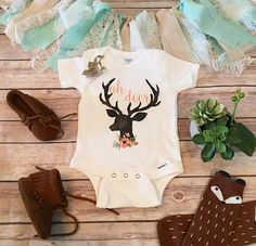 Oh Deer Baby Bodysuit or T-Shirt Oh Deer Boho baby bodysuit (or T-Shirt) with adorable deer head with antler silhouette, watercolor flowers and Oh Deer printed on the chest. Perfect for your newest little country baby girl. Also makes a great baby shower gift for the future little deer