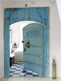 I like that this is an exterior door re-purposed for an interior