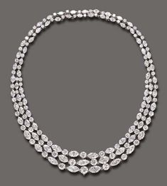 AN ELEGANT DIAMOND NECKLACE, BY HARRY WINSTON  The front designed as three graduated rows of circular and marquise-cut diamonds, to the similarly-set two-row backchain and clasp, mounted in plated white 18k yellow gold