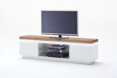 An enviable jewel of home entertainment, unique tv stands is a large furniture piece that reflects the beauty and elegance of minimalist contemporary aesthetics tv stand wood. Not only does this entertainment unit look great, but it also comprises functional characteristics to meet the storage expectations of the most demanding homeowners. flat panel tv stand, cool tv stands