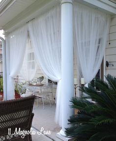 """I guess this is """"porch week"""" at 11 Magnolia Lane. Amy showed you her screened porch on Wednesday, and I'm showing you our back porch today. Many of you know that we moved from Nashville, Outdoor Curtains, Sheer Curtains, Outdoor Rooms, Outdoor Living, Outdoor Furniture, Ikea Curtains, Outdoor Kitchens, Outdoor Patios, Hanging Curtains"""