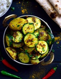 This simple dish of Indian-spiced potatoes and zucchini is a total flavour bomb! Two main ingredients and a handful of spices make up this tasty vegan or vegetarian dish. Can be served as a side or main along with rice and naan or chapati. Zucchini Vegetable, Zucchini Side Dishes, Vegetable Side Dishes, Vegetable Recipes, Vegan Lunch Recipes, Cooking Recipes, Healthy Recipes, Chapati, Vegan Dishes