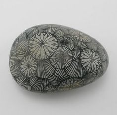 This looks simple enough. A bowl full of decorated rocks picked up while we travel would be a fun conversation piece.