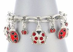 Red Crystal Ladybug Charm Bracelet- Feel like a child... that I want this so bad.