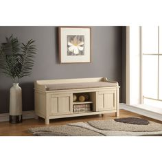 Furnish your hallway, child's room, or great room with this attractive, cream-colored, storage bench. The foam-filled seat cushion offers a comfortable place to sit, while the lower wooden portion fea
