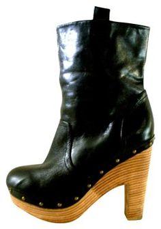 https://www.tradesy.com/shoes/dolce-vita-dv-leather-platform-black-boots-11040352/?tref=closet