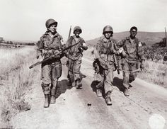American paratroopers after jumping into southern France near Le Muy in Operation DRAGOON, Aug. 15, 1944.