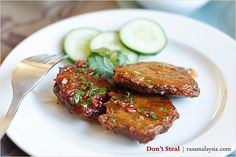 Thai Fish Cake - golden-brown fish cakes with chili sauce and fresh cucumber. #seafood #fish #thai