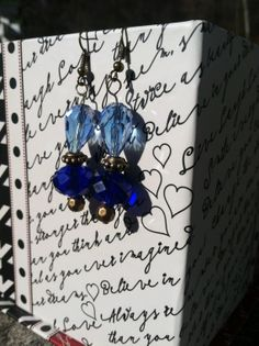 Beautiful blue dangle earrings. Made with glass and by ReadyByDawn, $10.00