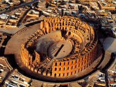 The Amphitheatre of El Jem, Tunisia was built in the 3rd century in the ancient Roman town of Thysdrus. It is the largest Roman amphitheatre in North Africa - holding between 27,000 and 30,000 people making it possibly the third or fourth biggest in the Empire after the Colosseum (or Coliseum) in Rome and that at Capua.. - was also used for filming some of the scenes the film Gladiator.
