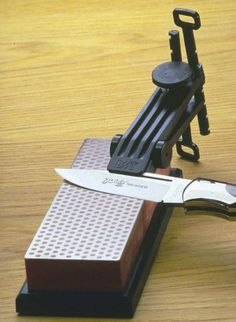 DMT Knife Sharpening Guide..make this with brass screw adjust and maple clamp, perhaps lined with suede or drawer liner for grip.
