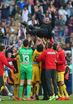 Diego Simeone the coach of Club Atletico de Madrid is thrown in the air by his players after winning the La Liga after the match between FC Barcelona and Club Atletico de Madrid at Camp Nou on May 17, 2014 in Barcelona, Catalonia.