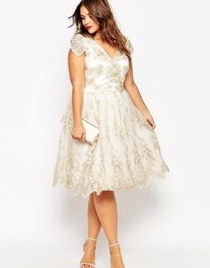 7 Gorgeous Short Plus Size Summer Wedding Dresses: Sexy short sleeve plus size summer wedding dress with V-neck and floral lace overlay by Chi Chi London