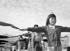 Ansel Adams: Manzanar calisthenics, 1943 Ansel Adams: Female internees practicing calisthenics at Manzanar War Relocation Center, Owens Valley, California, 1943. First in a series of pictures from Ansel Adams' stay at the Japanese-American relocation camp in 1943.