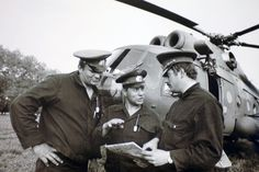 https://flic.kr/p/9y1Gvf | 02790018 | Historical collections of the Chernobyl accident. - Pilots supplied the zone with food products, medicine and everything else necessary. Photo: crew of the helicopter MI-8 before a flight to the chernobyl Atomic Power Station area: Commander V. Surkov (centre), pilot-navigator Ye. Yelnikov (right) and flight technician V. Borschchevsky, the men distinguished themselves during decontamination activities.