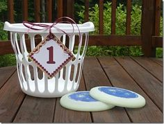 Frisbee into hamper. Have a couple and make each one farther away. If you get it into the ones farther away, you get more points.