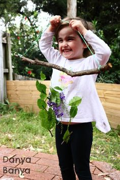 Proud nature mobile maker! Help preschool aged kids to make a nature mobile from leaves, flowers, twigs and sticks. Works on fine motor skills, threading and appreciation of nature. ~ Danya Banya