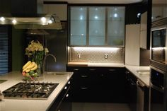 kitchen black cabinets white countertops | kitchen using ABSTRAKT White cabinets and NEXUS Brown-black. White ...