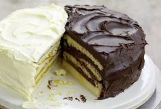 Lemon Doberge Cake Recipe. Doberge cake is the birthday cake of New Orleans and every bakery in the city offers their take on the filled and stacked layered cake, the most popular option being the half-and -half, a Doberge with a lemon-chocolate split personality—literally, a lemon-filled-and-iced cake on one side and a chocolate-filled-and-iced cake on the other.