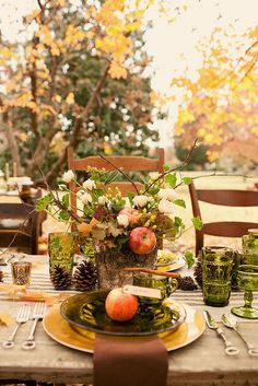 Love the centerpiece here with the apples and twigs