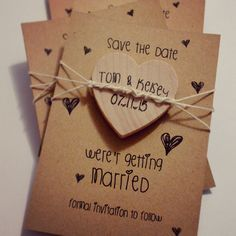Home made save the dates, rustic wood heart magnets.