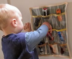 Wall organizer.. Would be good for hanging in closet to organize small toys
