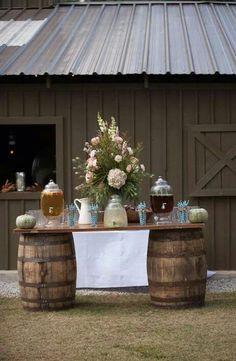 Barrels holding a beverage bar