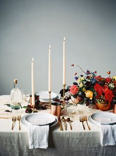 Long Candlesticks, Gold Cutlery and A Colourful Flower Centrepiece   Tabletop
