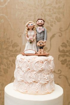 Puppy love for the cake topper http://www.desireehartsock.com/a-pretty-in-pink-blush-wedding-that-is-a-valentines-day-treat/