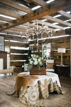 hide rug layered over tablecloth in the barn <3  #design #interior #inspiration by Edith Grevious