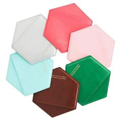 "Honeycomb Card Case      Product details:    Two Pockets. Synthetic Leather. 4"" x 4.5"" (10.2 cm x 11.4 cm)  $24"
