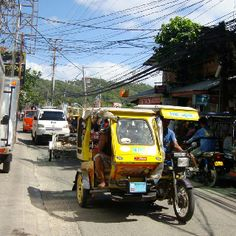 Tricycle- a form of transportation in the Philippines. Rode on these all the time.