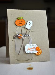 An acetate mason jar and sweet cake pops are a not-so-scary Halloween card. Keep it simple and easy using a kraft card base. DIY card