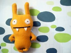 Haha love this crazy animal, guess its made of felt and it should be pretty easy to make as a pressie for a new baby!