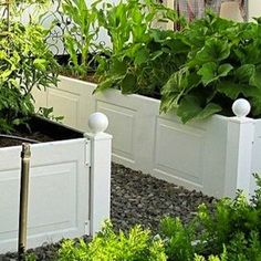 Garage Door Ideas - 10 Innovated Repurposed Garage Doors -Raised Plant Beds Separate the panels of a steel garage door to create raised beds for your backyard. The best part of this use is that there's no modification required; once they've been broken apart, the panels can be used as is.