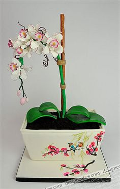 Sugar work orchids, fondant leaves, and a cake base. Now your cake can double as your centerpiece!