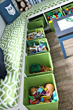 Two tall bookshelves on their sides, bins for storage and custom cushions. Play room