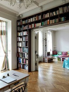 built in bookshelves around a large door frame.