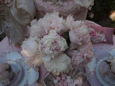 Marie Antoinette meets with her dressmaker table
